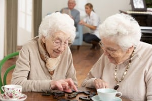 two women playing dominos