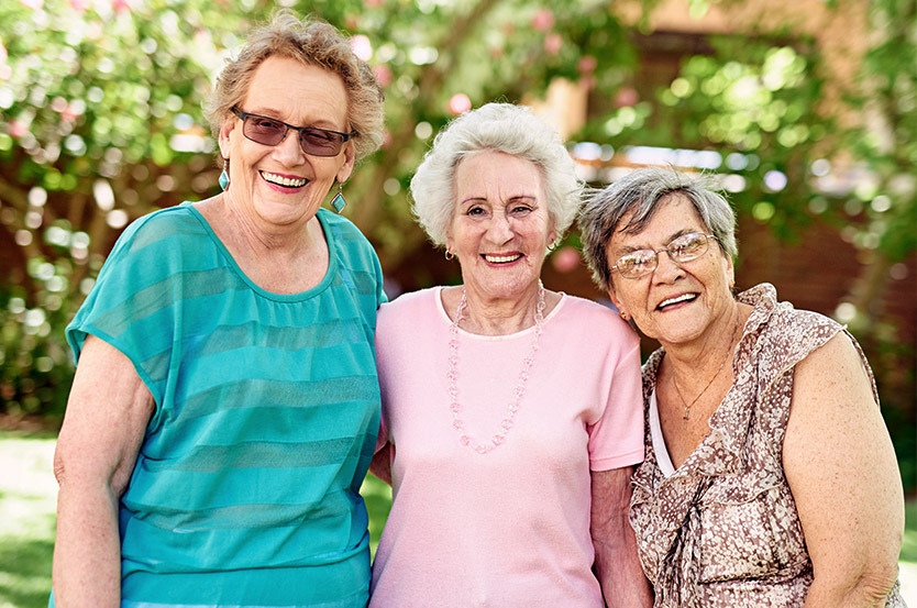 women in retirement community smiling