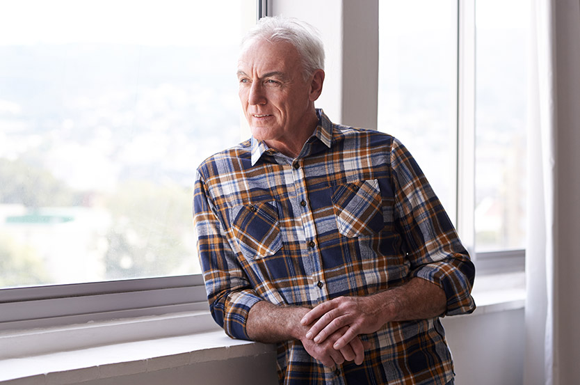 senior man considering on a retirement community