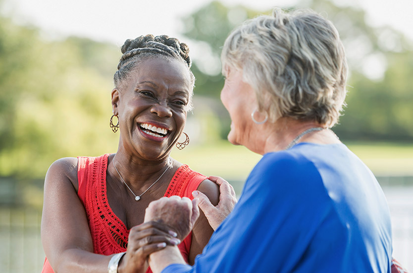 senior woman laughs with retiree