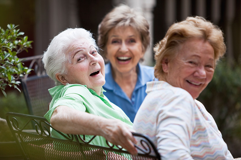 women in senior living community laughing