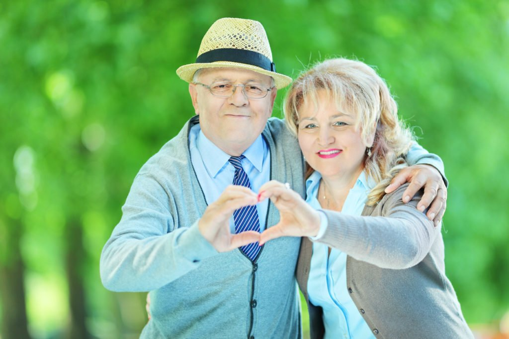 two residents making a heart with their hands for senior heart health