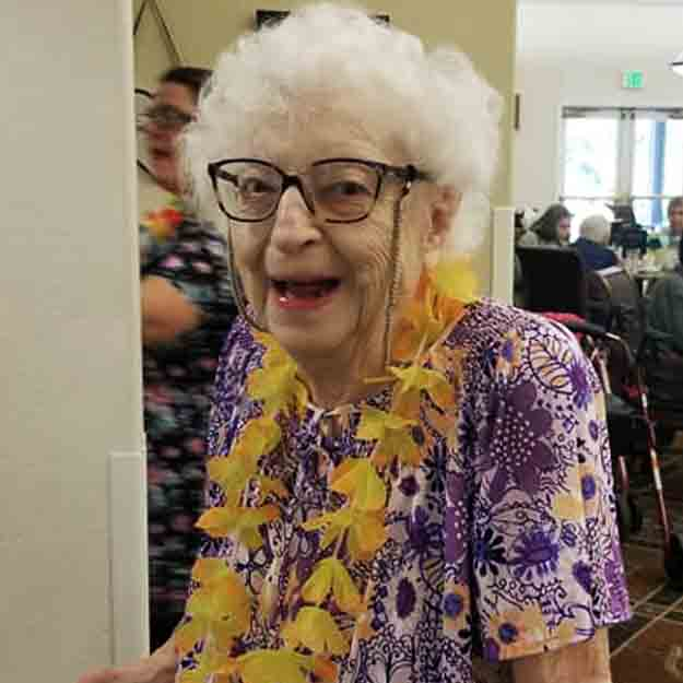 Laughing senior with Flower Garland