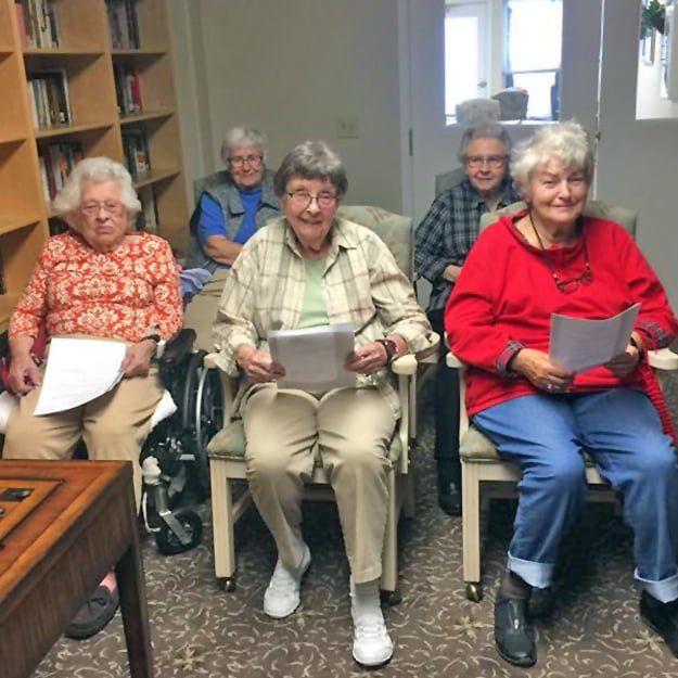 Seniors together reading