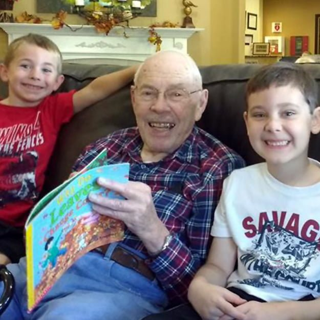 Senior Living gentleman resident with family Gibson Creek by Bonaventure