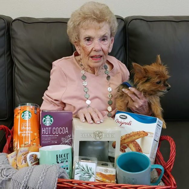 senior living resident with Puppy at Bonaventure of Salmon Creek