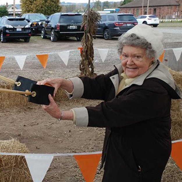 Senior Living lady resident pumpkin toss at Cedar Ridge by Bonaventure