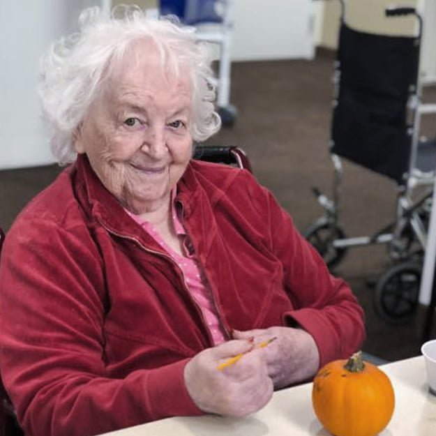 Senior Living lady resident Pumpkin painting at Bonaventure of Gresham