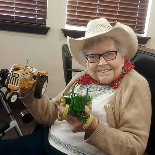 Assisted Living lady resident with tractors - Colorado Springs