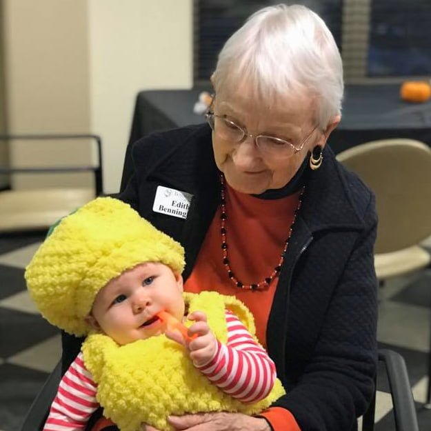 Senior living resident with Baby at Bonaventure of Salem