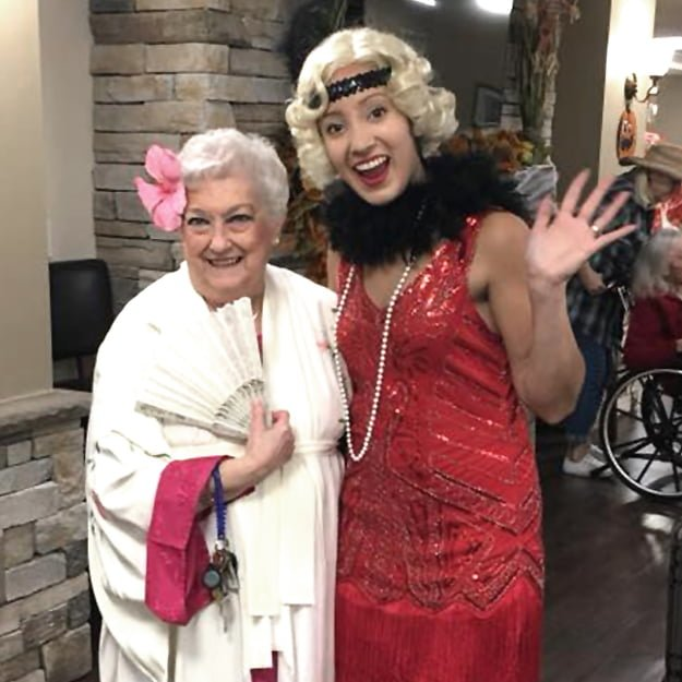 Assisted Living lady resident and guest in fancy dress - Albany
