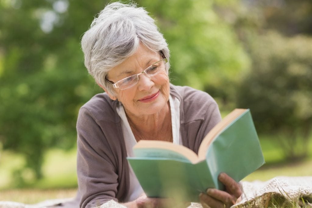 senior read reading book dementia alzheimer's retire retirement