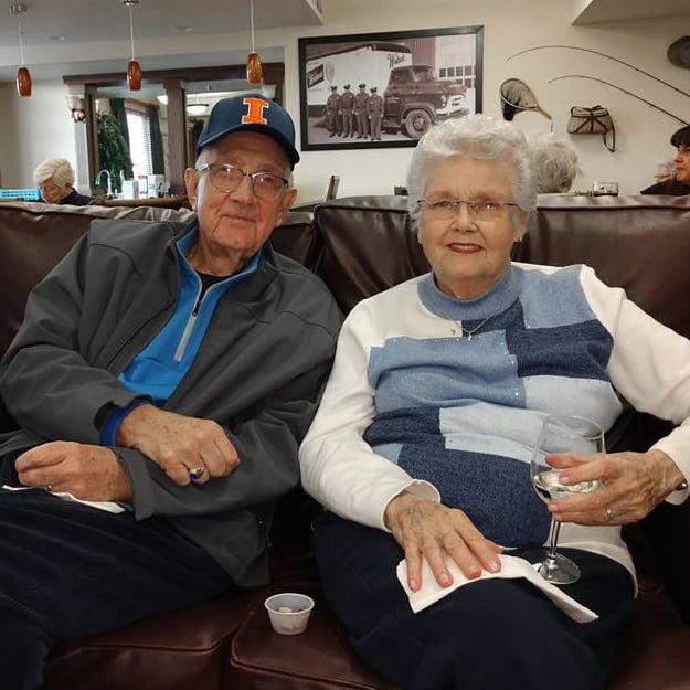 2 seniors sitting in their independent living community in Pueblo Colorado