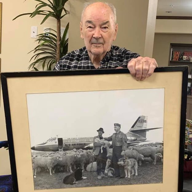 Senior holding photo in Bonaventure of Gresham independent retirement living community
