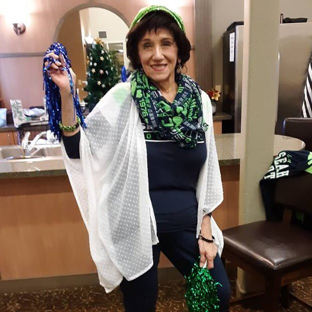 Retired senior woman has fun in her assisted living community
