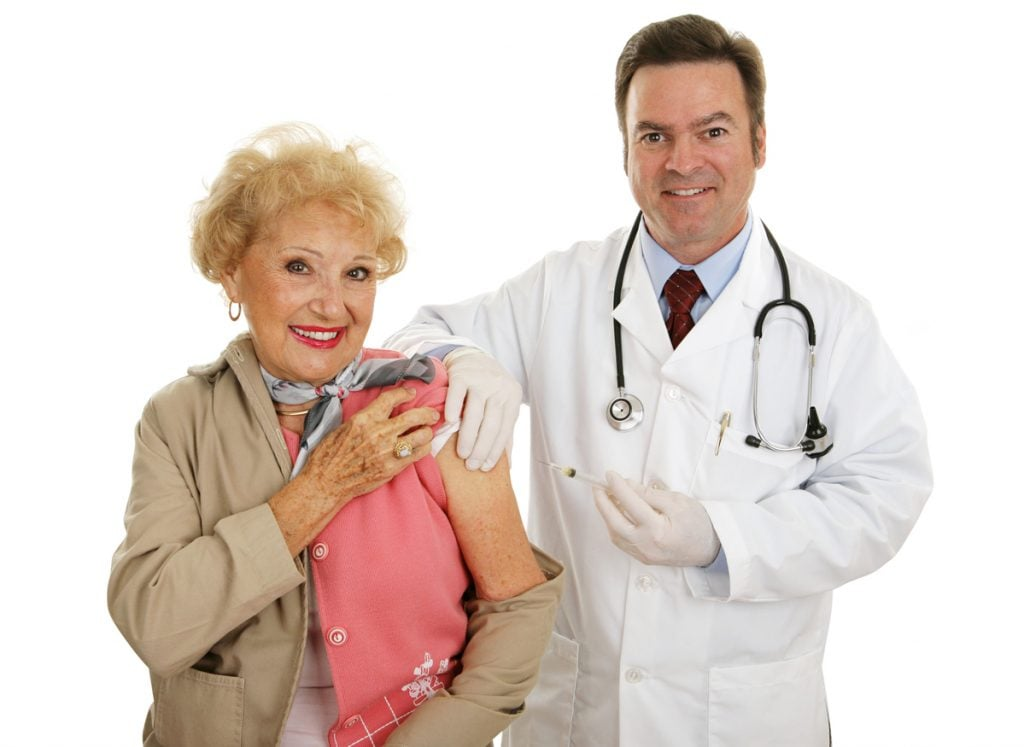 senior woman and doctor after a flu shot in independent living community and assisted living community