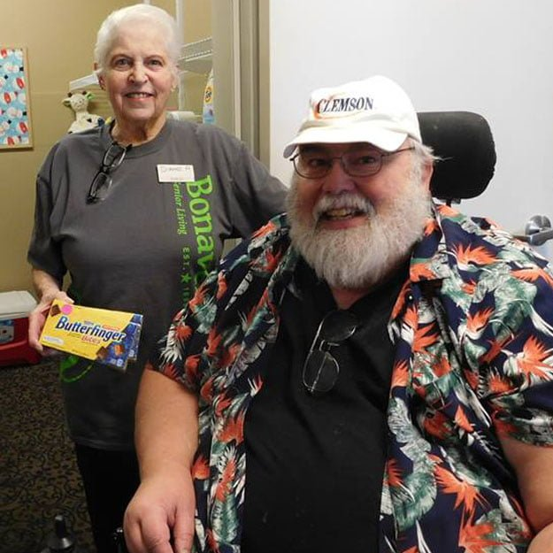 Womand and man are retired and happy with independent living retirement community
