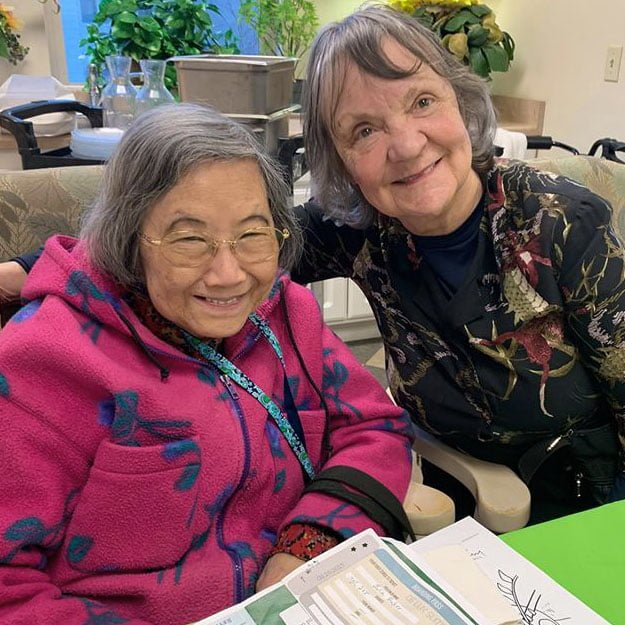 Assisted living seniors smiling for their independent living