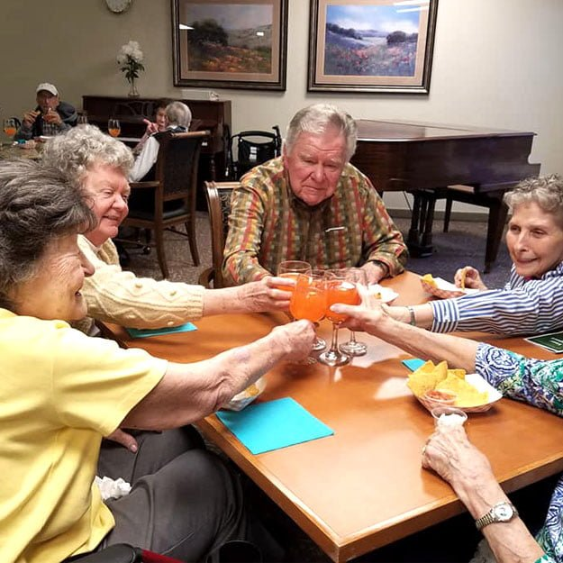 Senior enjoy drinking in their assisted living community because they like their retirement