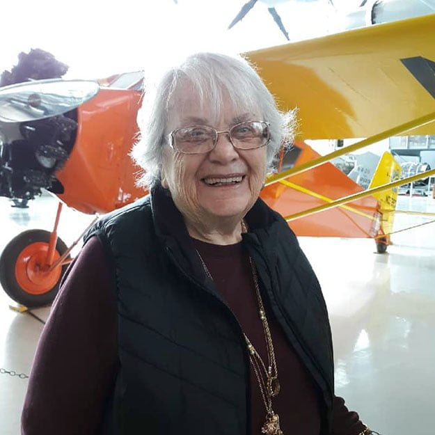 Independent living community senior is happy about planes