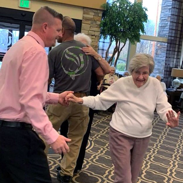 Assisted living lady enjoys dancing in her retirement living community for seniors