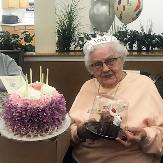 Assisted living senior enjoys her birthday and her retirement living community