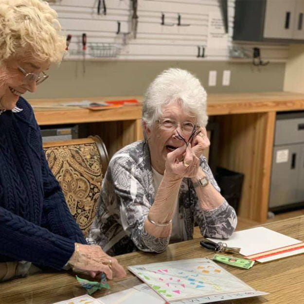 Assisted living community lady is retired and happy doing art