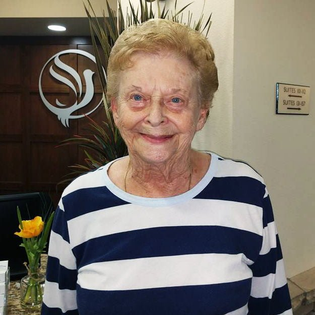 Senior lady smiles in her assisted living memory care community