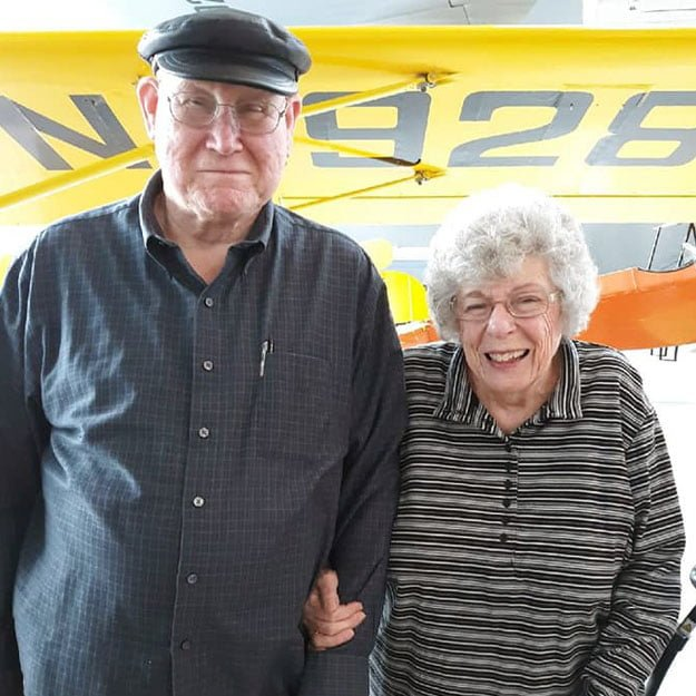 Assisted living seniors smile with plane because they love retirement living communities