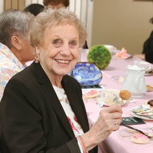 Retired woman is happy living in her assisted living community