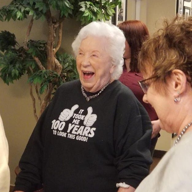 Woman in senior living community assisted living loves her retirement