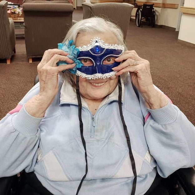 Independent living woman enjoys masks in her retirement