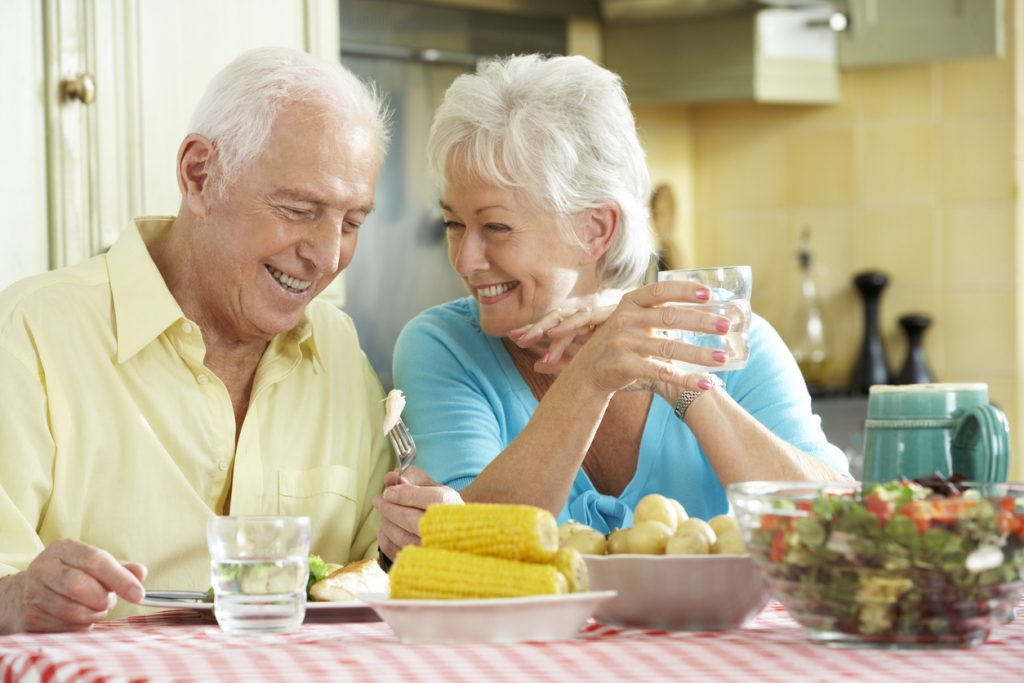Assisted living or memory care seniors eating in their dieting retirement