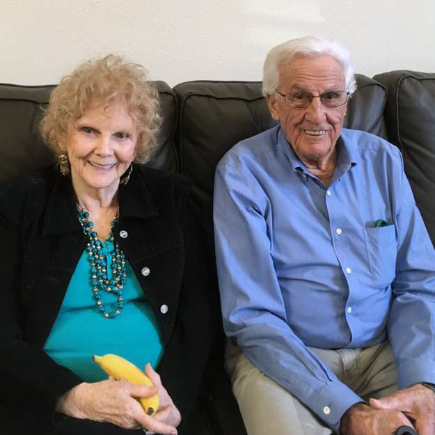 Memory care seniors sit and enjoy assisted living and independent living community
