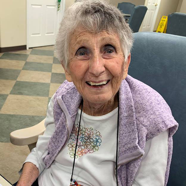 Memory care senior happy with her assisted living community for retirement