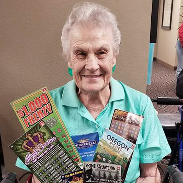 Senior holds tickets in her retired years in a assisted living or memory care community