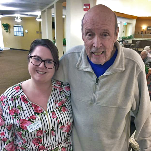 Assisted living man with woman in memory care retirement independent living community