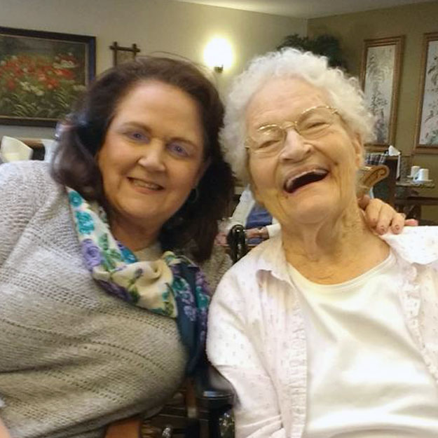 Retirement senior community people laughing because they love memory care and assisted living