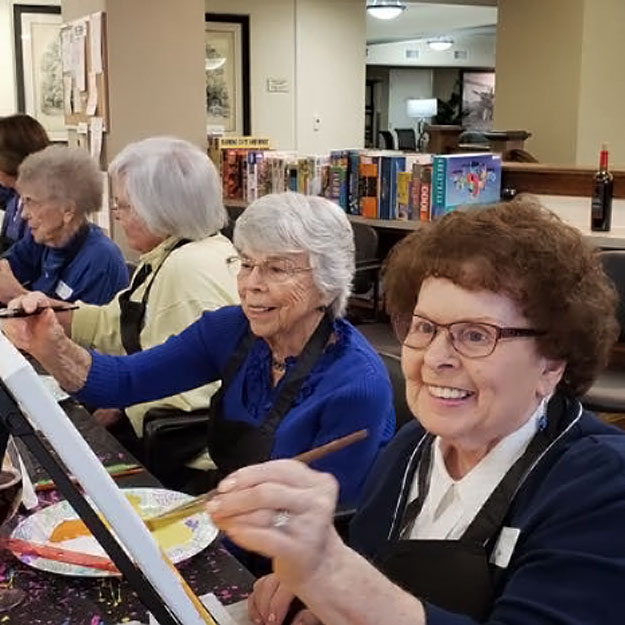 Painting seniors like living in assisted memory care in their retirement