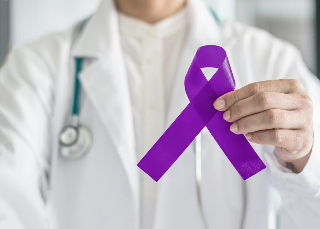 alzheimer's care doctor holds ribbon for stress and dementia alzheimer research
