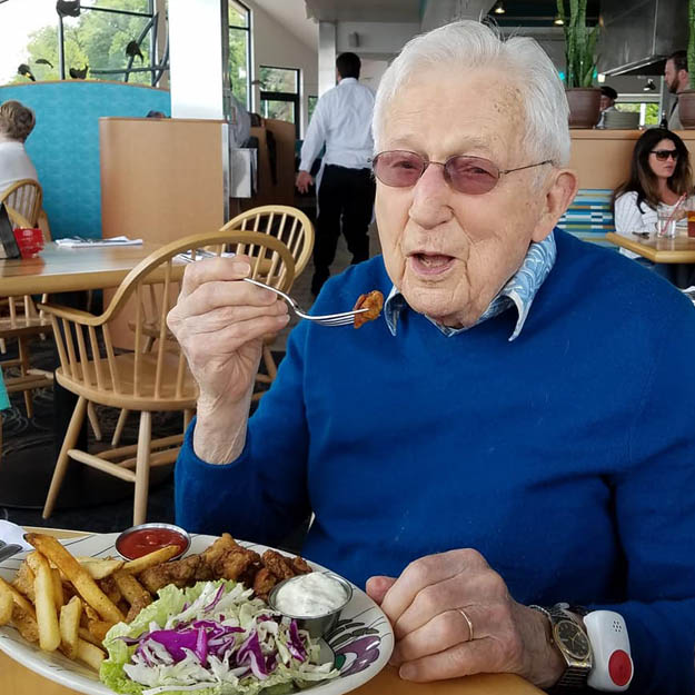 The food is tasty by senior man in independent living community for memory care and assisted living