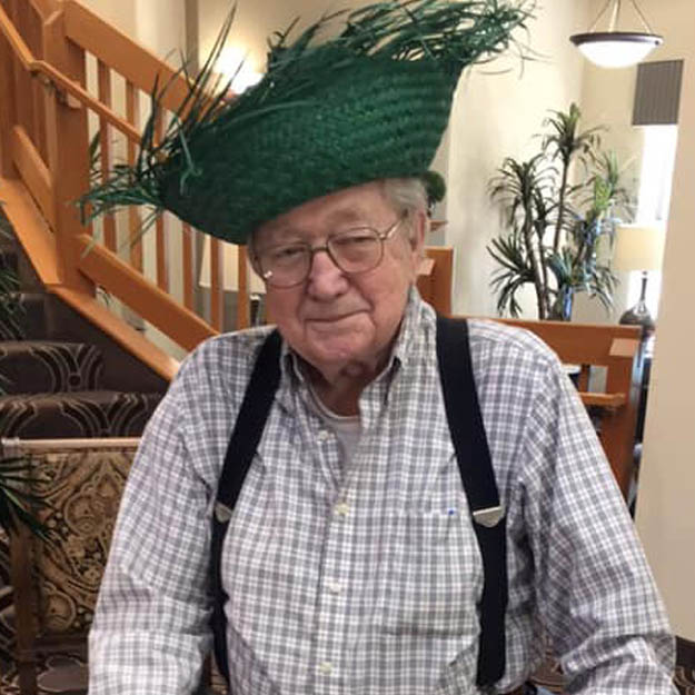 Retirement living community senior loves hat in assisted living