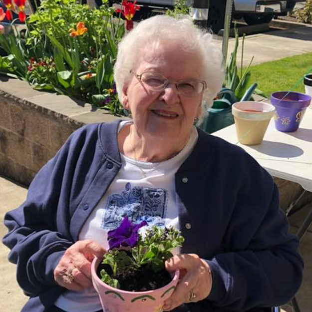 Memory care senior likes plants and retirement community