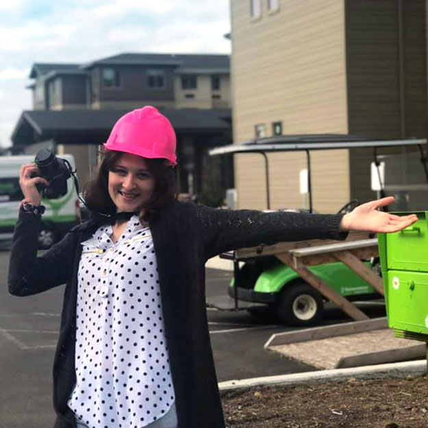 Senior living community worker with pink hat