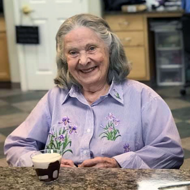 Smiling senior woman loves living in memory care
