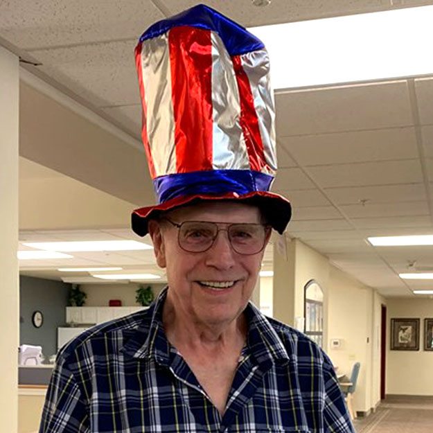 Senior man wears hat in independent living community