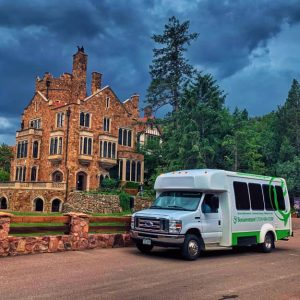 senior living bus in front of castle of assisted living community