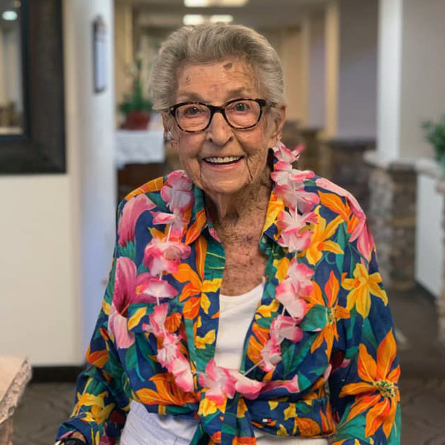 Happy senior woman in her assisted living retirement community for memory care and independent living