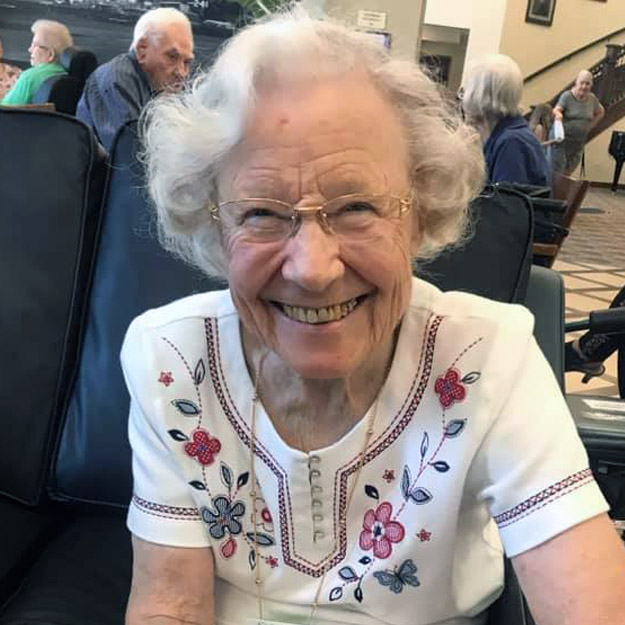 Happy senior woman enjoys assisted living community for retirement seniors and memory care