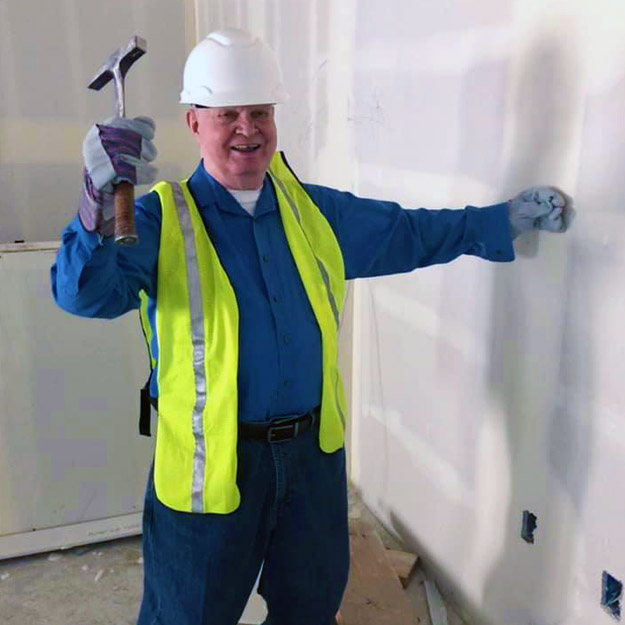 Senior man in construction builds senior living community for assisted and memory care retirement